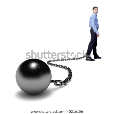 Man's legs dragging a ball and chain, selective focus. - stock photo