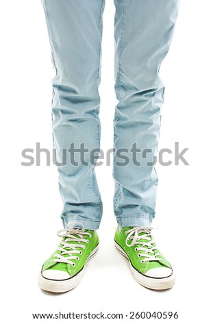 Man's legs in vintage green shoes. Isolated on white background  - stock photo