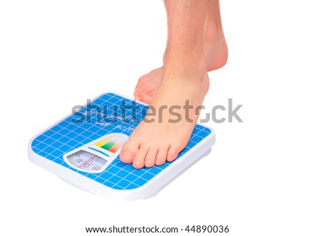 Man's legs , which  weighed on floor scale. Isolated - stock photo