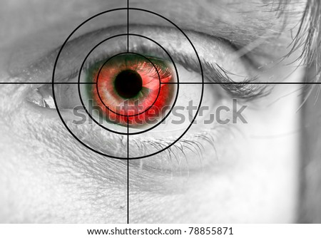 Man's red eye and target close up