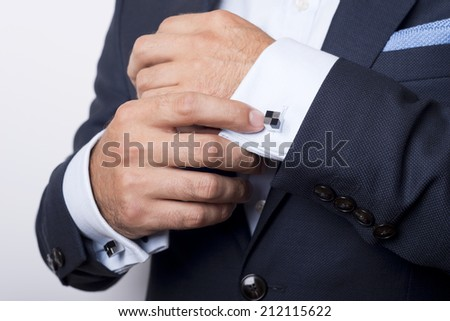 Man's style. dressing suit, shirt and cuffs - stock photo