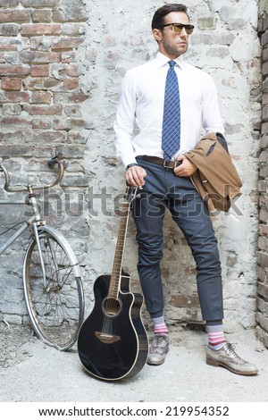 Man's style, dressing, suit, shirt, guitar - stock photo