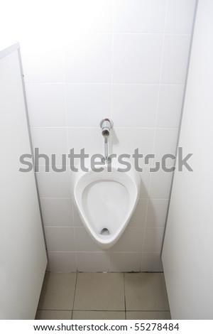 Man's toilet. Urinal - stock photo