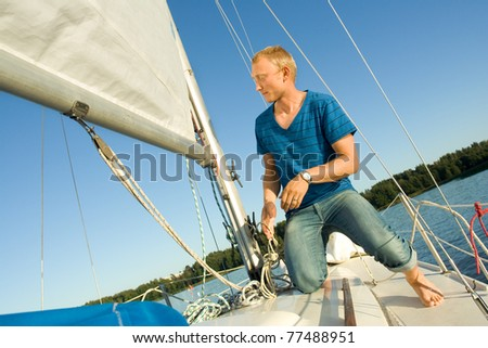 Man sailing - stock photo