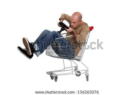Man sat in trolley - stock photo