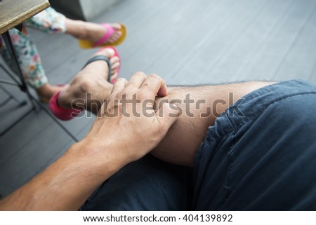 Man scratch the itch with hand - stock photo