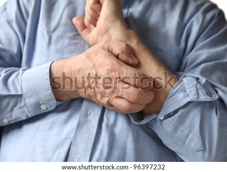 man scratches his arm - stock photo