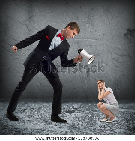 man screams at the frightened woman, the concept of aggression