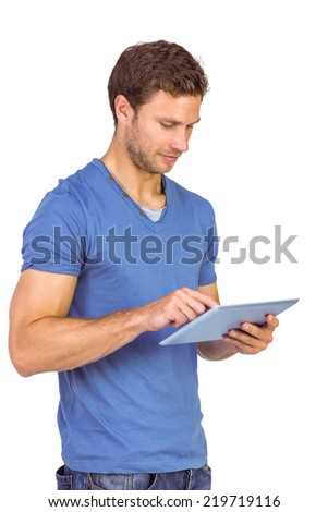 Man scrolling through tablet pc on white background