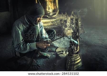 Man sculpting Buddha statue.man working by hand crafts.