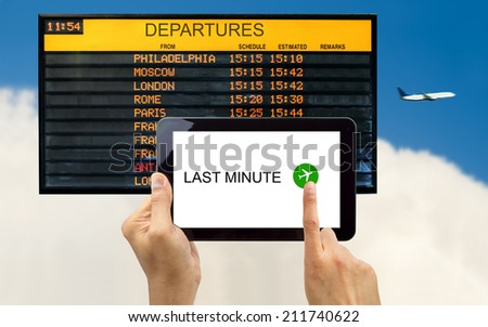 man search for last minute deals at an cloud with your tablet - stock photo