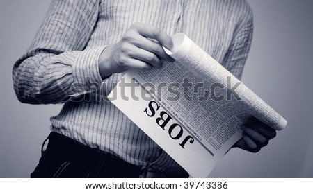 man seek for a job  in a newspaper - stock photo