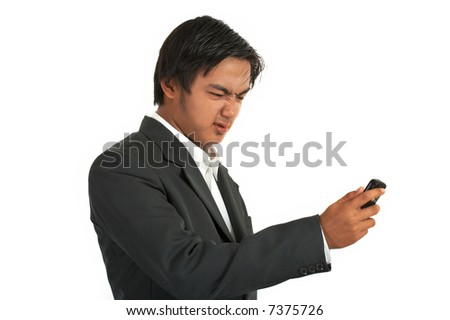 man sending a text message on a cellphone - stock photo
