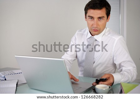 Man sending text message whilst at work