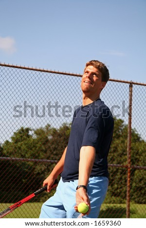 Man Serving Tennis Ball - 7 - stock photo