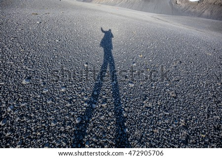 Man shadow on stones in Iceland