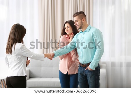 Man shaking hands with estate agent in new home