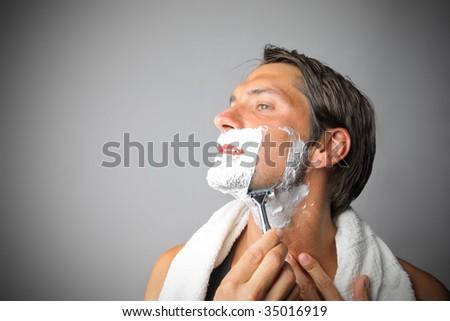 man shaving - stock photo