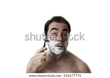 man shaving two week  of facial hair growth of his face - stock photo