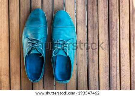 Man shoes on wooden background - stock photo