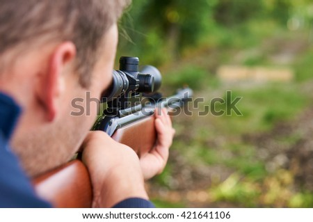Man shoot wit air rifle.                                - stock photo