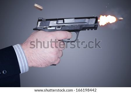 Man shooting a gun - stock photo