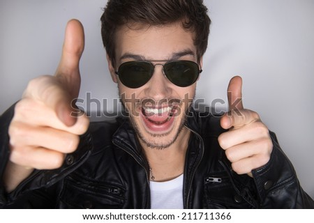man shooting gesture on white background. Portrait of man showing gun sign - stock photo