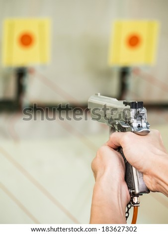 Man shooting with air gun on target - stock photo