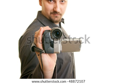 man shoots with a camera - stock photo