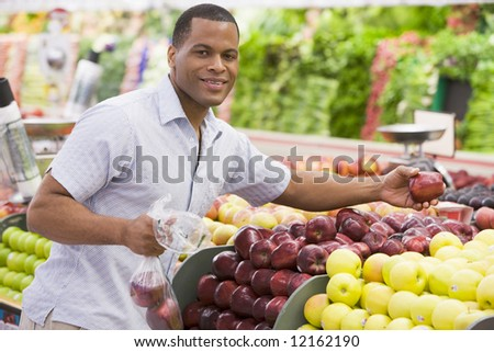 Man shopping in produce section of supermarket