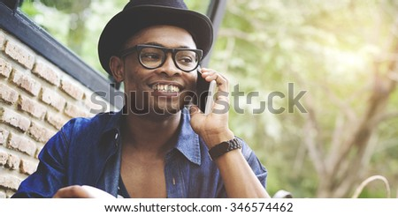 Man Shopping Outdoor Talking Mobile Phone Concept - stock photo