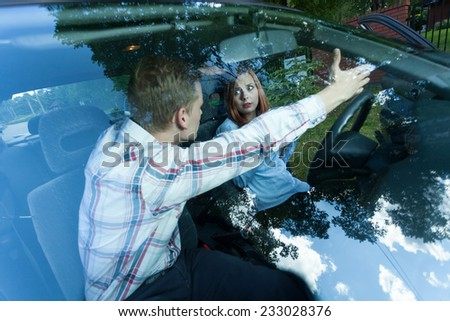 Man shouting at female driver in a car - stock photo