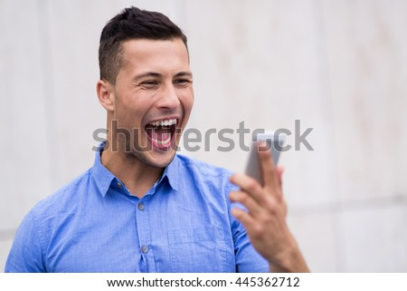 Man shouting at mobile phone  - stock photo