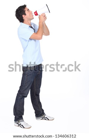 Man shouting into megaphone - stock photo