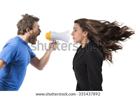 Man shouting with megaphone to a businesswoman - stock photo