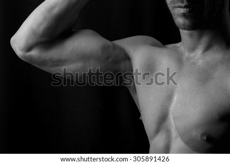 Man showing biceps in black and white detail