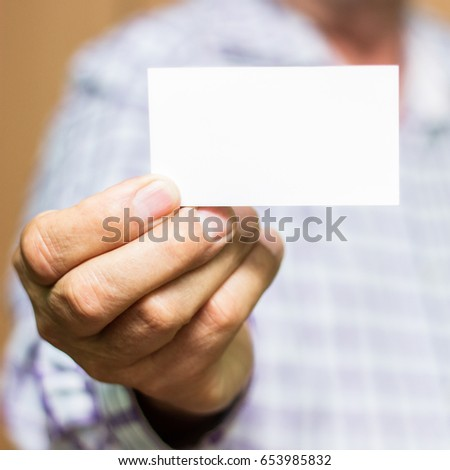Man showing blank white business card