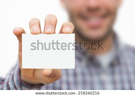 Man showing business card - stock photo