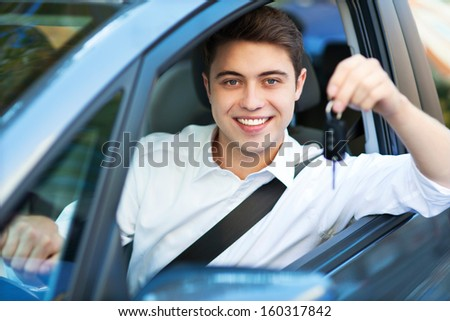 Man showing car key - stock photo