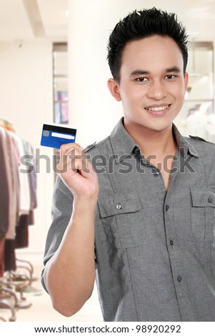 man showing credit card for shopping - stock photo