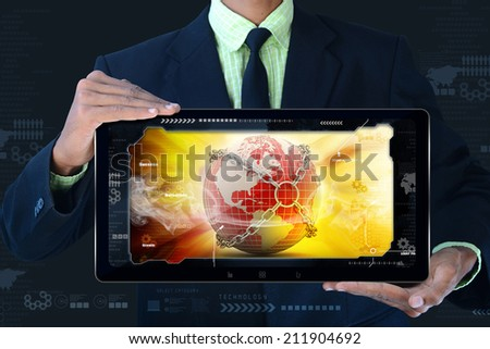 Man showing Earth globe close in chain   in tablet computer - stock photo