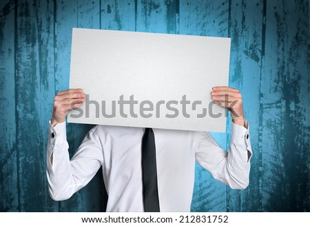 Man showing empty white board