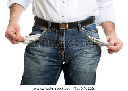 Man showing his empty pockets. - stock photo
