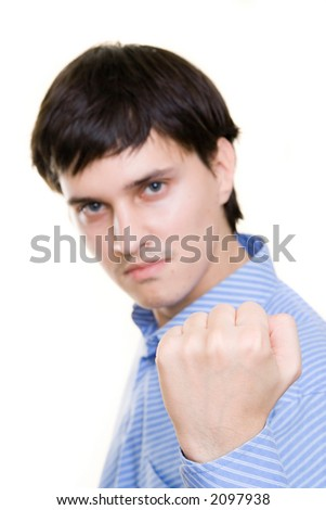 Man showing his fist, focused on fist - stock photo