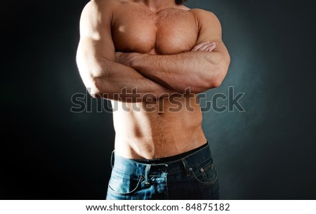 Man showing his muscular body - stock photo