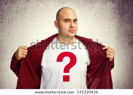 Man showing his white t-shirt with red question mark.