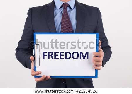 Man showing paper with FREEDOM text - stock photo