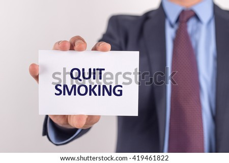 Man showing paper with QUIT SMOKING text