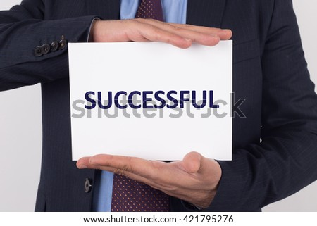 Man showing paper with SUCCESSFUL text - stock photo