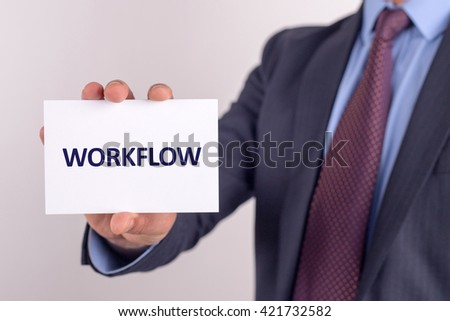 Man showing paper with WORKFLOW text